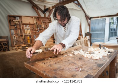 Artisan working the wood in the medieval market celebrated in the city of Avila, Spain, on September 7, 2018