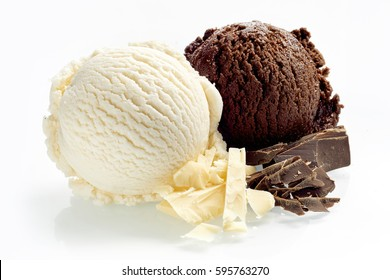 Artisanal dark and milk chocolate ice cream or Italian gelato with chopped bars of candy alongside as ingredients on a white background showing the texture of the scoops