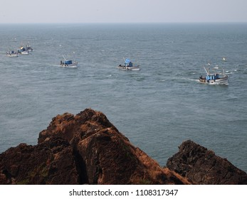 Artisanal fisheries fleet returning to port after a day's fishing, in Goa, India