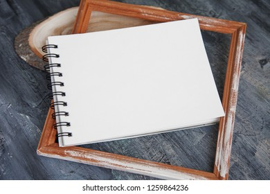 Artist Album Mock Up Template with brush and paints Artistic notepads with empty pages on black wood table background for portfolio design