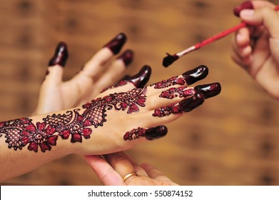 Artist Applying Henna Tattoo On Bride Stock Photo Edit Now