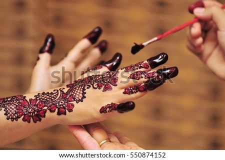 8936cc7ecc313 Artist Applying Henna Tattoo On Bride Stock Photo Edit Now