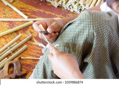 Artist carving bamboo for paper umbrella, Inle Lake Myanmar (Burma)