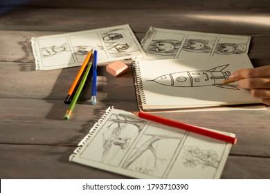 Artist drawing an anime comic book in a studio. Wooden desk, natural light. Creativity and inspiration concept.