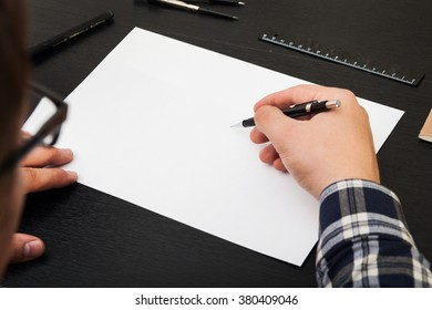 Artist drawing on white A4 paper list, stylish workplace