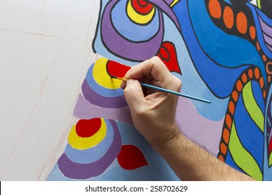 The artist draws a line in the picture.
