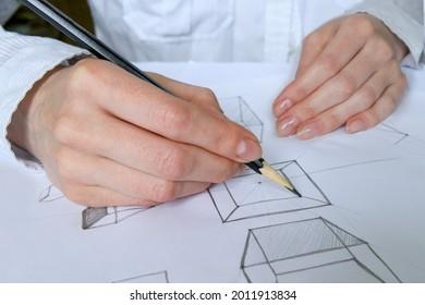 The artist draws  with pencils on paper. Art Studio.  Ideas of creativity.