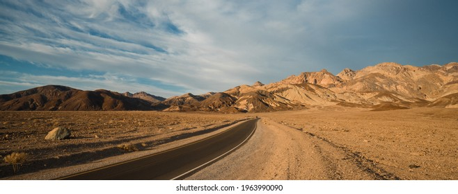 Artist drive in Death Valley Ca. A oneway winding road runs along colorful mountains and mud hills.