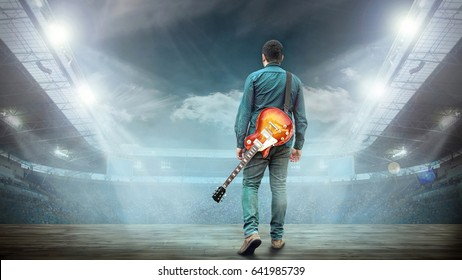 Artist Guitarist hands play on electricity guitar under light, Practicing in playing . Song entertainment and music instrument.