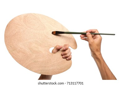 Artist hands with paintbrush and empty palette, isolated on white background