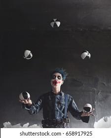 artist juggler clown play with balls