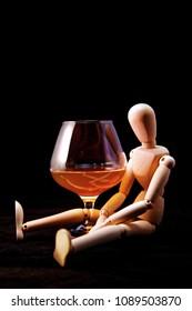 Artist mannequin drinking concept, liqour, drunk