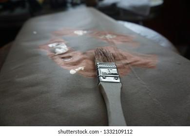 Artist Paintbrush laying on Cloth - Close Up