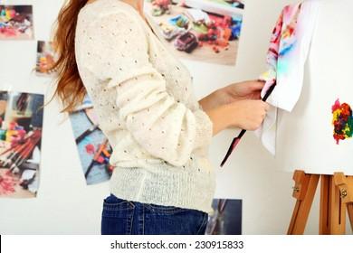 Artist painter on canvas in art studio
