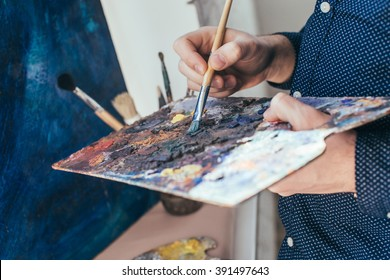 Artist painting an abstract oil picture