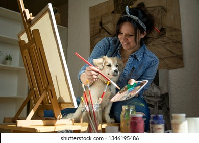Artist painting with dog
