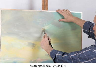 An artist painting in studio