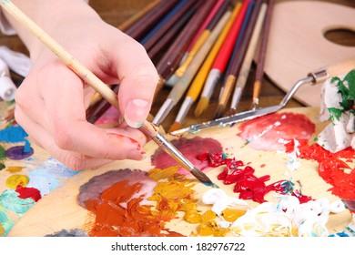 Artist paints picture close-up