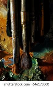 The artist paints a portrait of oil on canvas