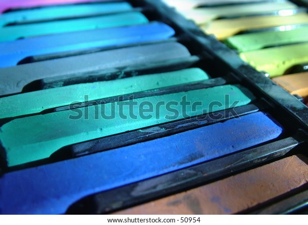 Artist pastels in cool colors.
