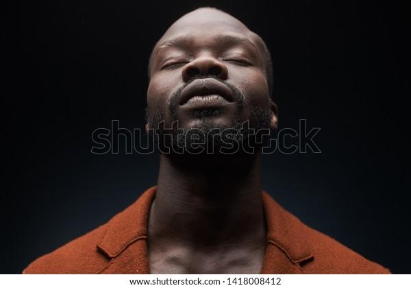 Artist, performer. Portrait of bearded man in orange coat