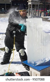 An artist sculpting a block of ice for a competition