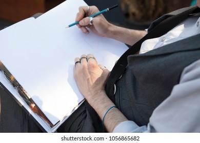 Artist Sketching in Notebook