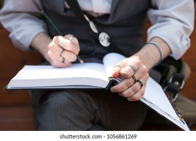 Artist Sketching in Notepad