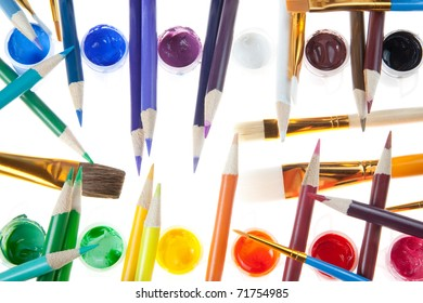 The Artist Tools - Colored Pencils and Paint with various size Brushes.