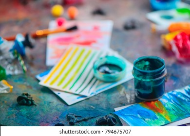 Artist tools in creative occupation concept. Brushes, watercolor swatches and paints. Artistic workplace.