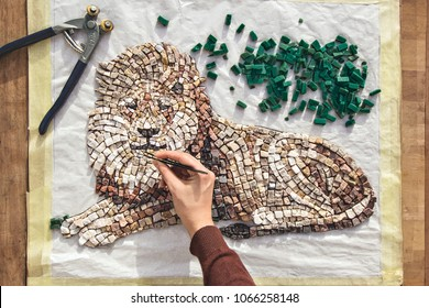 Artist Working, Holding Tweezers And Making Mosaic Art