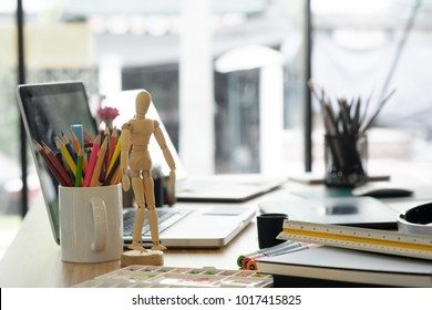 artist workplace with office supplies object on desk.