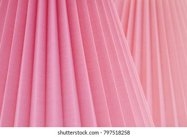 Artistic Abstract with Folded Rose Pink Fabric at Slanted Parallel Angles. A design background with room or space for copy, text, words, or a Wall Picture for Interior Decoration. Focus is near center