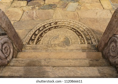 The artistic ancient moonstone in Anuradhapura ancient city, Sri Lanka. It is the carved semi-circular stone slab, placed at the bottom of staircases and entrance of the temple.