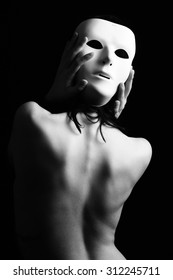 Artistic Back of a Woman in a mask