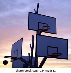 Artistic basketball backboard in a sunset sky