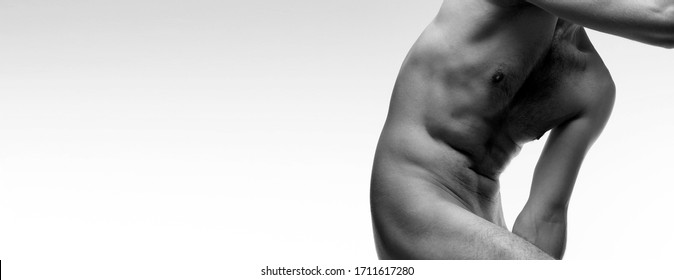 Artistic black and white photo of male torso, unrecognizable shirtless man, copy space banner