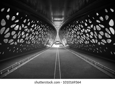 An artistic black and white photograph of a bridge in the city of Antwerp expressing symmetry, Belgium.