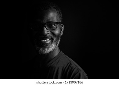 Artistic black and white portrait of a bearded black man