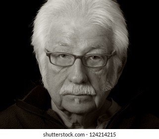 Artistic black and white portrait of a distinguished elderly man