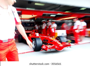 Artistic blur of Kimi Raikkonen out his pit during training session in Malaysia