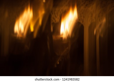 Artistic blurred long exposure light painting with burning oil candles on the dark background, religious festival, spiritual, emotional concept, copy space background for poster, flyer, advertisement