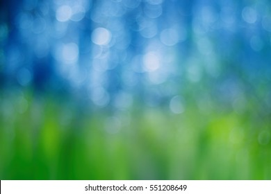 Artistic bokeh background. Soft defocused circular blue and green lights