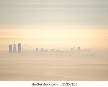 Artistic cityscape of Madrid city with fog in the morning. Artistic picture