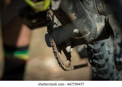 An artistic close up on a mountain biker's run