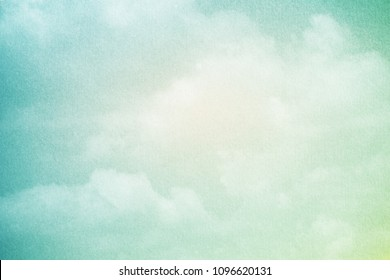 artistic cloudy sky with pastel gradient color and grunge paper texture, nature abstract background