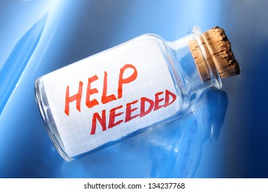 """An artistic concept of a vintage bottle with a cork saying """"Help needed"""""""