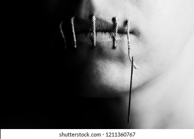 Artistic conceptual photo of a woman with stitches in her lips