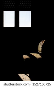 artistic and conceptual photography. Absence. A chair, a window to describe solitude with a photo