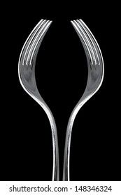 Artistic cup of wine form made with two forks isolated on black background